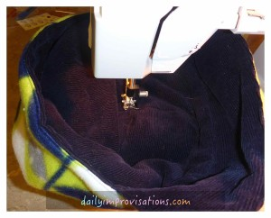 Stitching in ditch on the right side to attach the upper edge of the polar fleece lining to the crown.