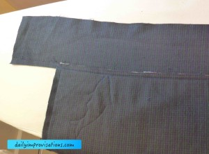 The first long edging piece has been sewn on and topstitched.