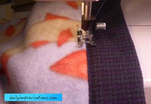 Stitching in the ditch of the seam where I first sewed the edge binding to the main blanket body.