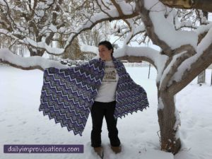 Natalie's zigzag blanket modeled in the snow